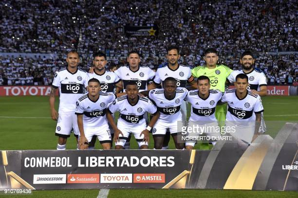 Paraguay's Olimpia players pose before their Copa Libertadores football match against Uruguay's Wanderers at the Defensores del Chaco stadium in...