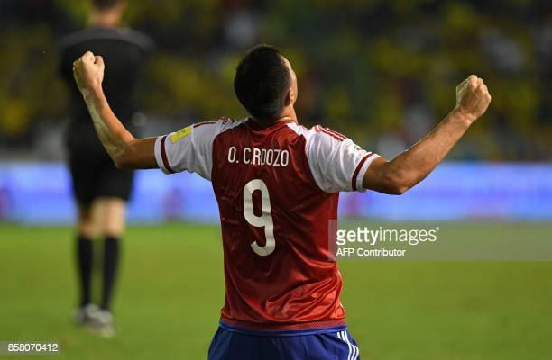 Paraguay's Oscar Cardozo celebrates after scoring against Colombia during their 2018 World Cup football qualifier match in Barranquilla Colombia on...