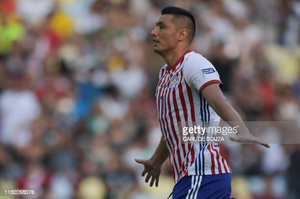 Paraguay's Oscar Cardozo celebrates after scoring against Qatar during their Copa America football tournament group match at Maracana Stadium in Rio...