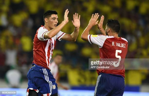 Paraguay's Oscar Cardozo celebrates with Paraguay's Bruno Valdez after scoring against Colombia during their 2018 World Cup football qualifier match...