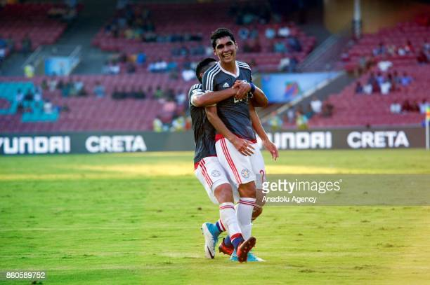 Paraguay's players celebrate a score during the FIFA U17 World Cup match between Turkey and Paraguay in Mumbai India on October 12 2017