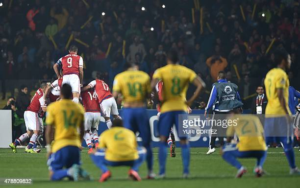 Paraguay's players celebrate after defeating Brazil in the penalty shootout of their 2015 Copa America football championship quarterfinal match in...