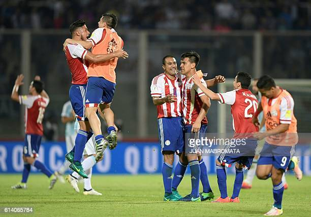 Paraguay's players celebrate their 01 team victory against Argentina at the end of their Russia 2018 World Cup football qualifier match in Cordoba...