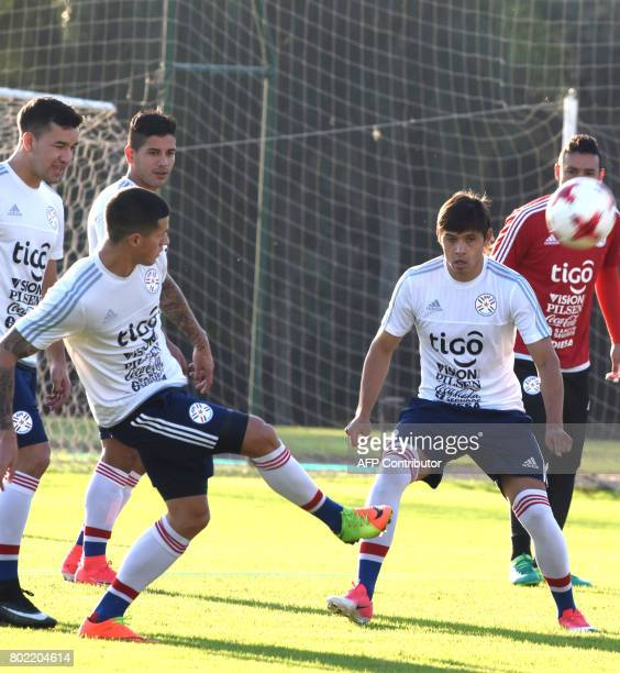 Paraguay's players Oscar Romero and Jorge Recalde participate in a training session in Ypane Paraguay on June 27 2017 ahead of their friendly match...