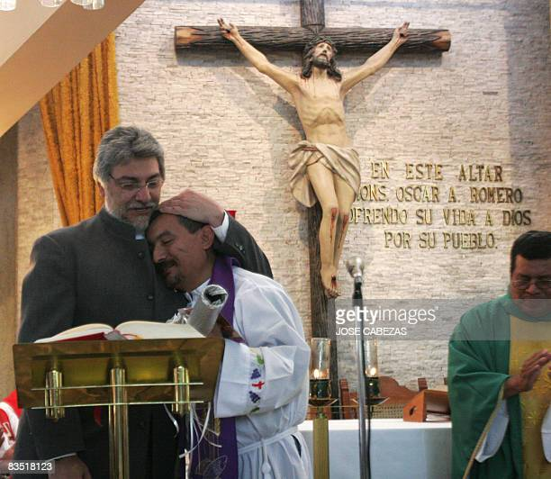 Paraguay's President Fernando Lugo hugs a priest at the chapel of the Divina Providencia Hospital during a mass in honor of Monsignor Oscar Arnulfo...