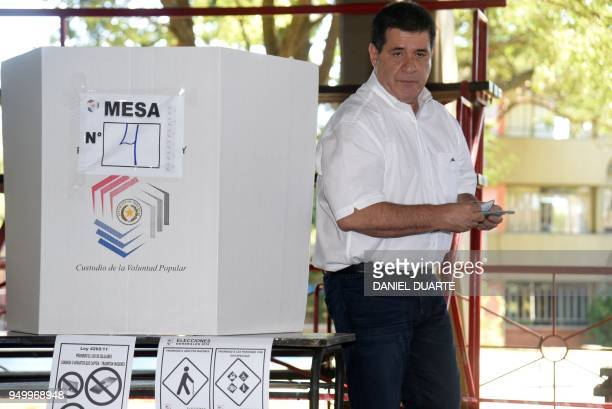 Paraguay's President Horacio Cartes votes at a polling station in Asuncion on April 22 during Paraguay's presidential election Opinion polls give...