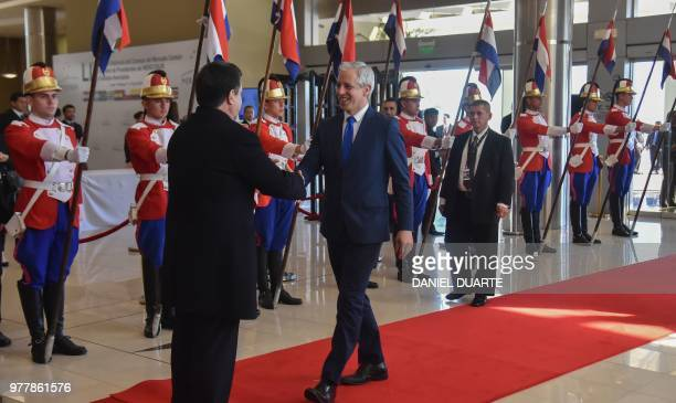 Paraguay's President Horacio Cartes welcomes Bolivia's VicePresident Alvaro Garcia Linera upon his arrival for the Mercosur Summit in Luque Paraguay...