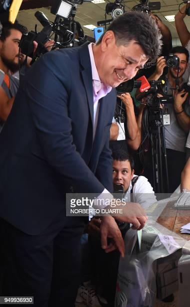 Paraguay's presidential candidate for the National Alliance party Efrain Alegre casts his vote at a polling station in Asuncion on April 22 2018...