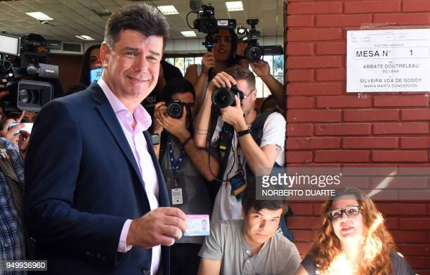 Paraguay's presidential candidate for the National Alliance party Efrain Alegre prepares to cast his vote at a polling station in Asuncion on April...