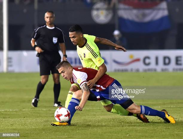 Paraguay's Robert Piris and Venezuela's Yangel Herrera vie for the ball during their 2018 World Cup football qualifier match in Asuncion on October...