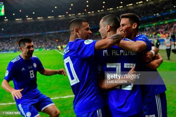 Paraguay's Rodrigo Rojas, Derlis Gonzalez, Miguel Almiron and Matias Rojas celebrate after teammate Richard Sanchez scored against Argentina during...