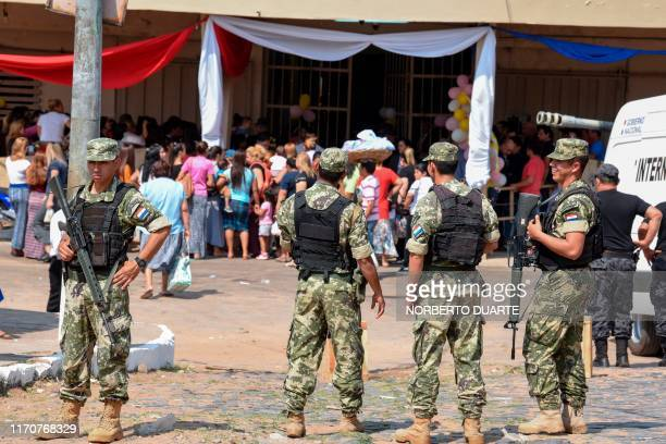 Paraguay's security forces stand guard outside Tacumbu prison in Asuncion on September 24 as part of measures taken by the government to strenghten...