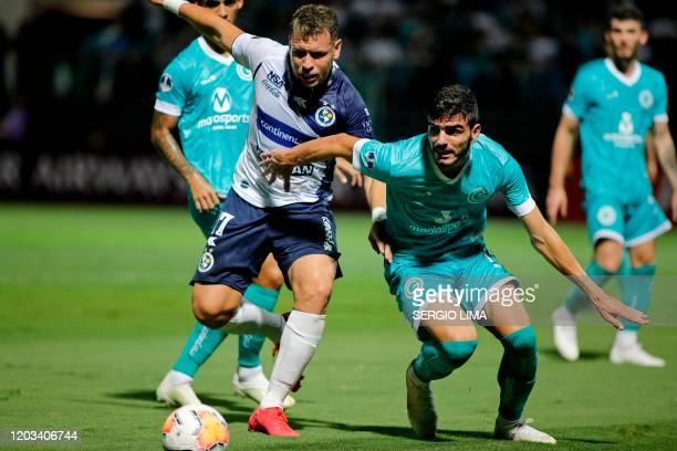 Paraguay's Sol de America Nildo Arturo Viera vies for the ball with Brazil's Goias Daniel Bessa during their Copa Sudamericana first round match at...