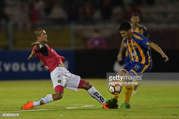 Paraguay's Sportivo Luqueno player Miguel Godoy vies for the ball with Ecuador's Deportivo Cuenca Facundo Melivillo during their Copa Sudamericana...