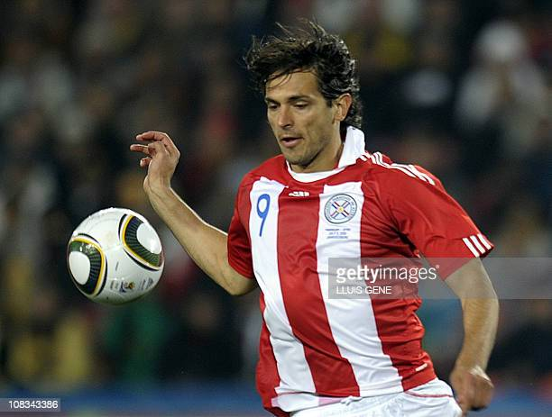 Paraguay's striker Roque Santa Cruz controls a ball during the 2010 World Cup quarterfinal football match between Paraguay and Spain at Ellis Park in...