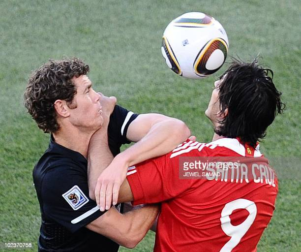 Paraguay's striker Roque Santa Cruz heads the ball ahead of New Zealand's defender Tony Lochhead during the Group F first round 2010 World Cup...