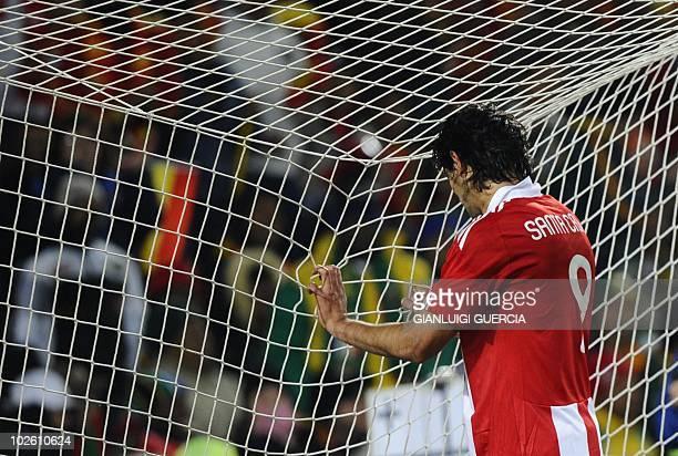 Paraguay's striker Roque Santa Cruz reacts after Spain's Spain's striker David Villa scored during the 2010 World Cup quarterfinal match Paraguay vs...