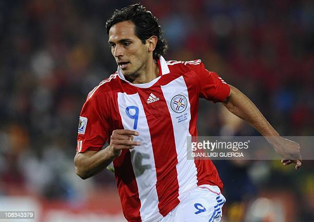 Paraguay's striker Roque Santa Cruz runs for the ball during the 2010 World Cup quarterfinal football match Paraguay vs Spain on July 3 2010 at Ellis...