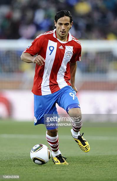 Paraguay's striker Roque Santa Cruz runs with the ball during the Group F first round 2010 World Cup football match Paraguay vs New Zealand on June...