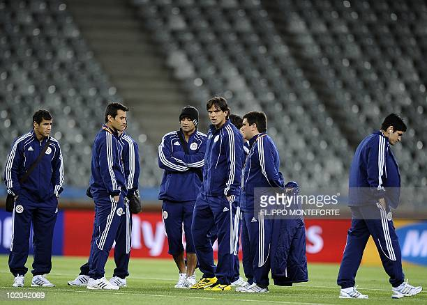 Paraguay's striker Roque Santa Cruz talks with teamates inside Cape Town's Green Point Stadium on June 13 2010 a day before 2010 World Cup football...