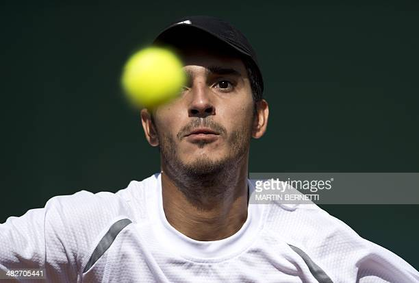 Paraguay's tennis player Gustavo Ramirez returns the ball to Chile's Cristian Garin during their Davis Cup match in Santiago on April 04 2014 AFP...