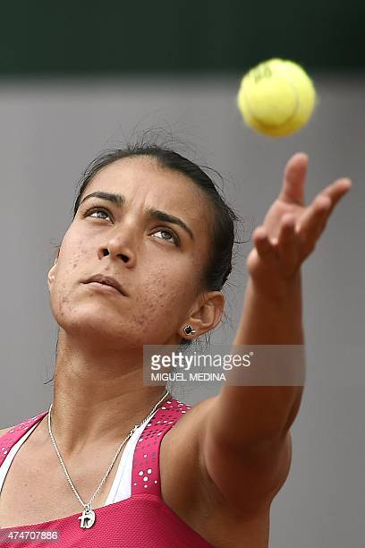 Paraguay's Veronica Cepede Royg serves to France's Virginie Razzano during the women's first round at the Roland Garros 2015 French Tennis Open in...
