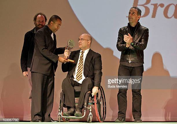 Paralamas do Sucesso receive a prize as the Best group of Pop/Rock during the 21st Brazilian Music Awards 2010 at the Theatro Municipal on August 11,...
