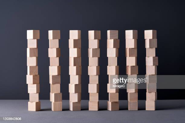 parallel stacking wood blocks - parallel stock pictures, royalty-free photos & images