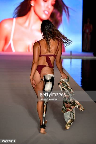 Paralympia Brenna Huckaby walks the runway for the 2018 Sports Illustrated Swimsuit show at PARAISO during Miami Swim Week at The W Hotel South Beach...