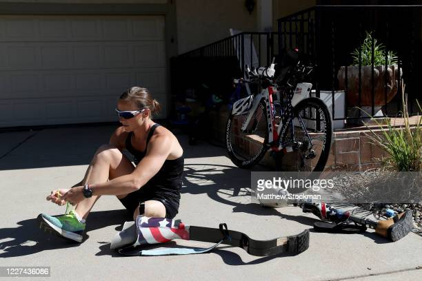 Paralympian and former US Army Officer Melissa Stockwell prepares to run during a training session on May 27 2020 in Colorado Springs Colorado...