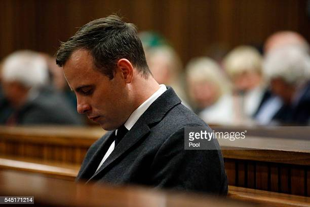 Paralympian athlete Oscar Pistorius accused of the murder of his girlfriend Reeva Steenkamp three years ago looks on during a hearing in his murder...
