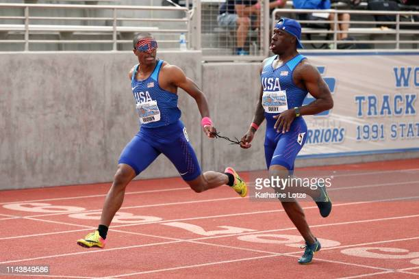 S Paralympian David Brown and his guide Jerome Avery cross the finish line in the visually impaired section of the men's 200 meter dash on the first...