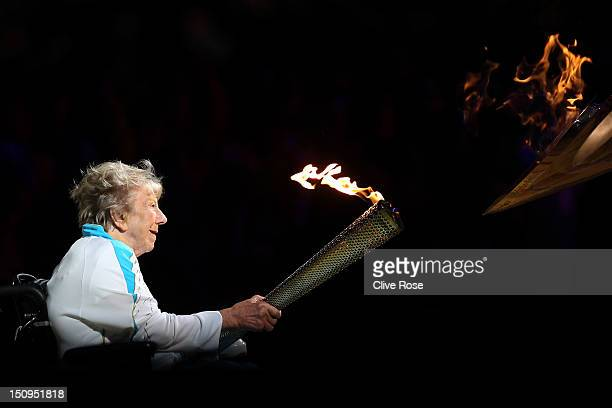 Paralympian Margaret Maughan lights The Paralympic Cauldron during the Opening Ceremony of the London 2012 Paralympics at the Olympic Stadium on...