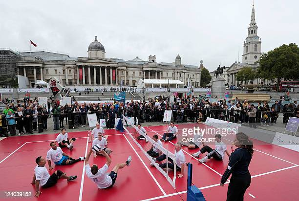 Paralympian sitting volleyball players take part in a successful world record attempt at the longest ever sitting volleyball rally during the...