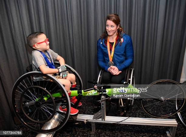 S Paralympian Tatyana McFadden coaches wheelchair racing to Angel City Sports athlete Asher Loera during Adaptive Sports in Action event presented by...