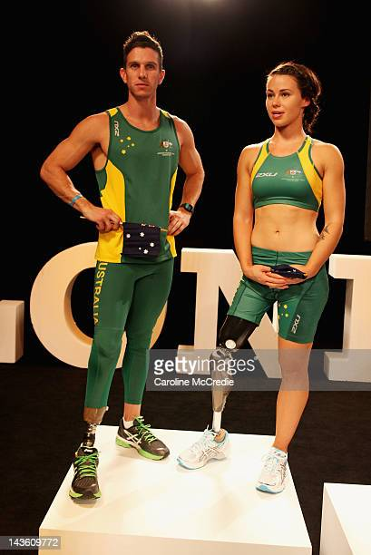 Paralympians Jack Swift and Kelly Cartwright showcase the 2012 Australian Paralympic team uniform on the catwalk on day two of MercedesBenz Fashion...