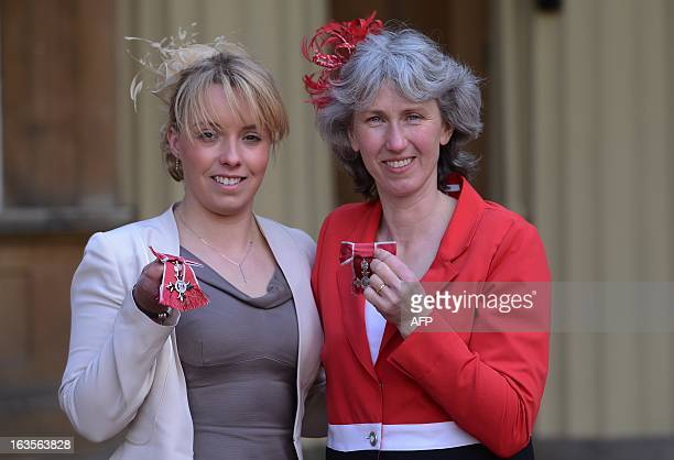Paralympians Sophie Wells and Deborah Criddle pose for photographs after they received an MBE's at Buckingham Palace in London on March 12 2013 AFP...