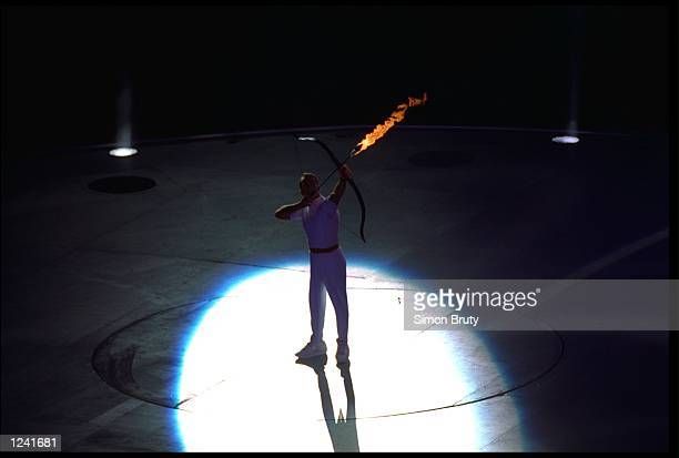 Paralympic archer Antonio Rebollo shooting lit arrow and lighting flame at Olympic Stadium Barcelona Spain 7/25/1992
