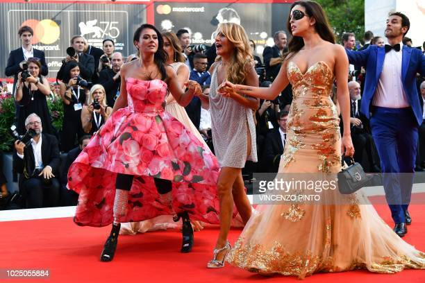 Paralympic athlete Giusy Versace Italian singersongwriter and television presenter Jo Squillo and former Miss Italy contestant and TV presenter who...