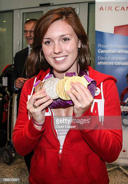 Paralympic athlete Summer Mortimer is greeted by her parents Craig and Janice Mortimer as she returns from London with her 4 medals in swimming, Two...