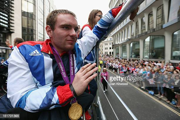 Paralympic gold medal winner in the T53 100m Mickey Bushell during the Olympics Paralympics Team GB victory parade through central London on...