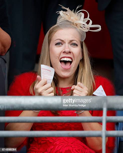 Paralympic Gold Medalist Hannah Cockroft cheers whilst watches the racing as she attends the QIPCO British Champions Day racing meet at Ascot...