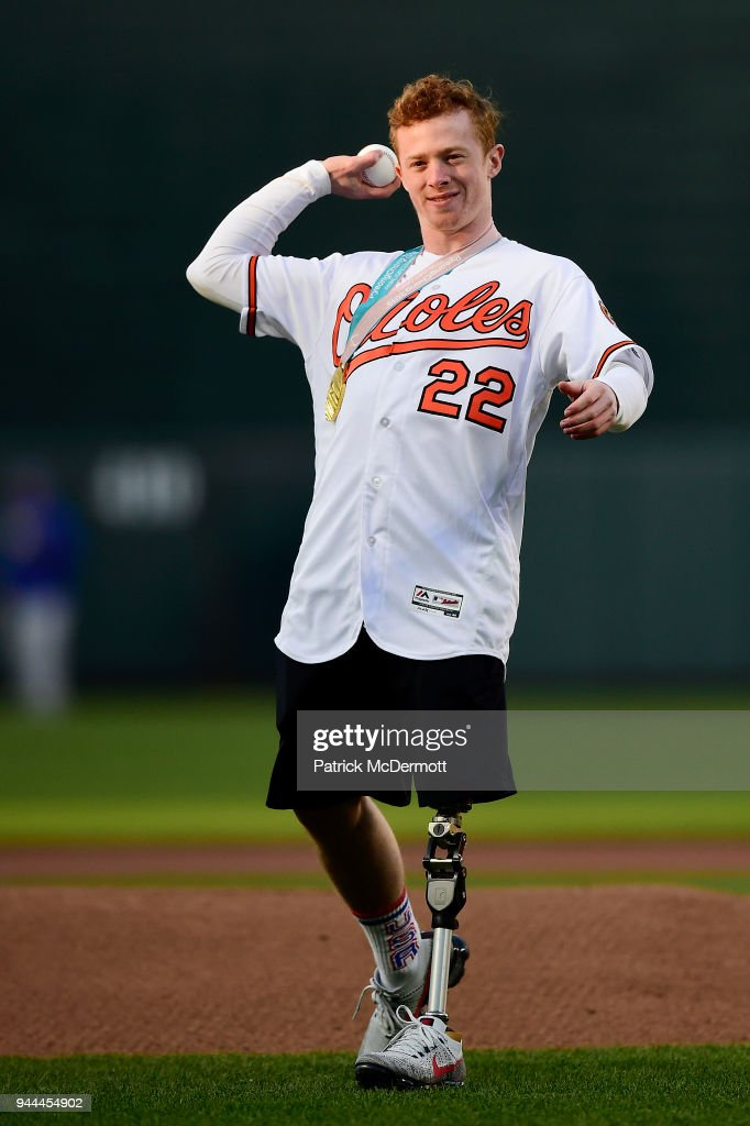 S. Paralympic men's sled hockey team member Noah Grove throws out the ceremonial first pitch before a game between the Toronto Blue Jays and Baltimore Orioles at Oriole Park at Camden Yards on April 10, 2018 in Baltimore, Maryland.