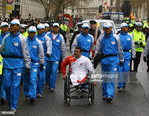 Paralympic powerlifter Ali Jawad carries the Olympic Torch on April 6 2008 in London England The torch for the 2008 Beijing Olympics is to be carried...