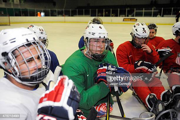 S Paralympic Sled Hockey Team athlete Brody Roybal listens to Assistant Coach Guy Gosselin during practice at the Sertich Ice Arena on February 26...
