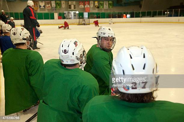 S Paralympic Sled Hockey Team athlete Brody Roybal listens to fellow teammate Josh Pauls as they discuss an offensive drill while attending practice...