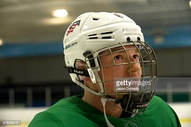 S Paralympic Sled Hockey Team athlete Declan Farmer listens to Head Coach Jeff Sauer discuss a team shooting drill while practicing at the Sertich...