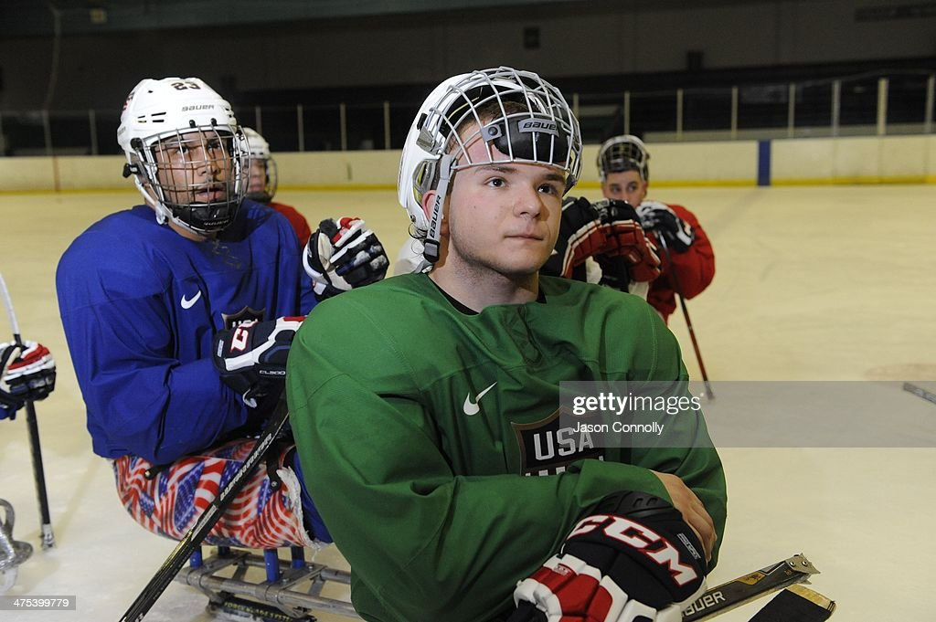 U.S. Paralympic Sled Hockey Team athlete Josh Pauls listens to Head Coach Jeff Sauer discuss a team shooting drill while practicing at the Sertich Ice Arena in Colorado Springs, Colorado on February 27, 2014. The team travels to Sochi, Russia this week to begin defense of their 2010 Paralympic gold medal at the 2014 Paralympic Winter Games in Sochi, Russia.