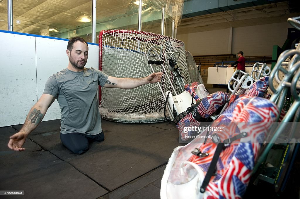 U.S. Paralympic Sled Hockey Team athlete Josh Sweeney stretches prior to the start of the the team's final U.S. based practice at the Sertich Ice Arena in Colorado Springs, Colorado on February 27, 2014. Sweeney, is one of four athletes on the team who has served, or is currently serving in the United States Armed Forces. The team travels to Sochi, Russia this week to begin defense of their 2010 Paralympic gold medal at the 2014 Paralympic Winter Games in Sochi, Russia.