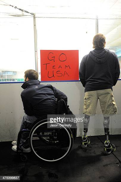 S Paralympic Sled Hockey Team athletes Adam Page and Josh Pauls watch as the ice is prepared by a zamboni at the Sertich Ice Arena in Colorado...
